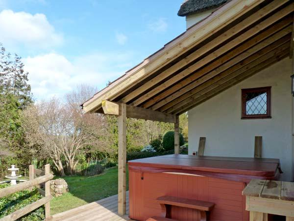SHELLS COTTAGE, pet friendly, character holiday cottage, with hot tub in - Image 1 - Washford - rentals