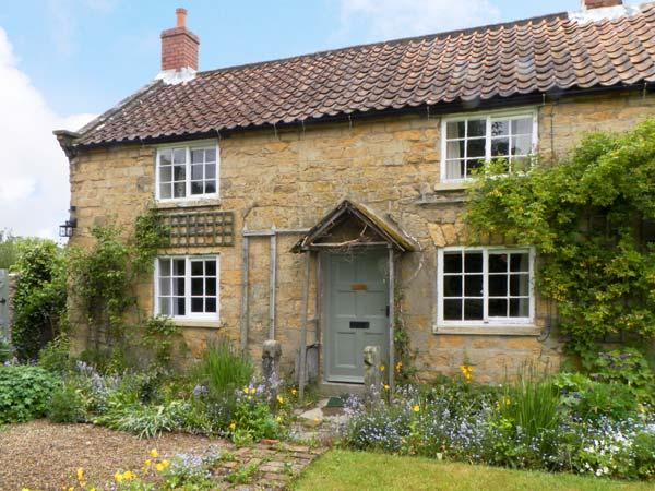 CORNER COTTAGE, pet friendly, character holiday cottage, with a garden in Cropton, Ref 12165 - Image 1 - Pickering - rentals