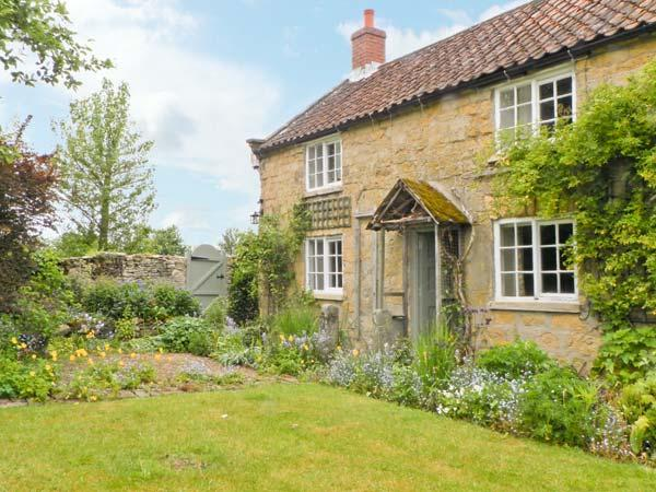 CORNER COTTAGE, pet-friendly, character holiday cottage, with a garden in Cropton, Ref 12165 - Image 1 - Pickering - rentals
