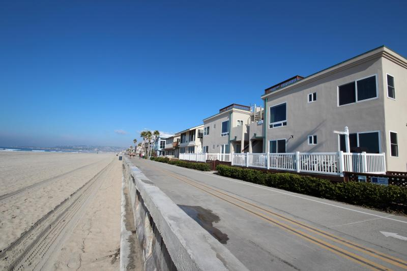 Right on the boardwalk! Our home is the bottom, front, right unit. - Ocean Front with Huge Private Patio! Kid-friendly! - Mission Beach - rentals