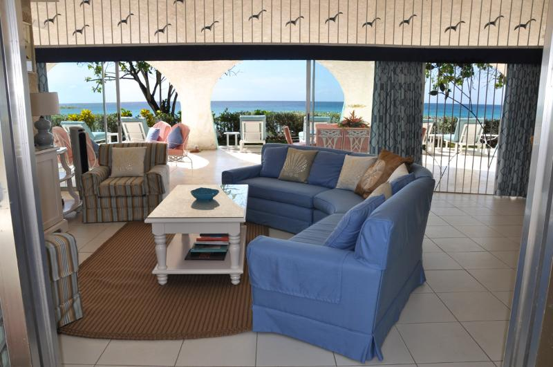 Living room enjoys a gentle breeze from open plan design - Family beach villa, walk to Sandy Lane & Holetown - Holetown - rentals
