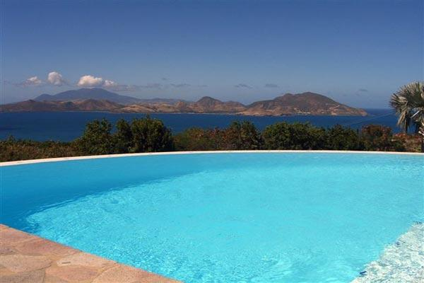 Ocean views towards St. Kitts, this villa blends Mediterranean and French Antillean architecture. WA CAS - Image 1 - Saint Kitts and Nevis - rentals