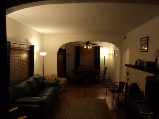 Living Room with fireplace to Dining Room through archway - Spanish Charmer By Beach & Entertainment District! - Daytona Beach - rentals