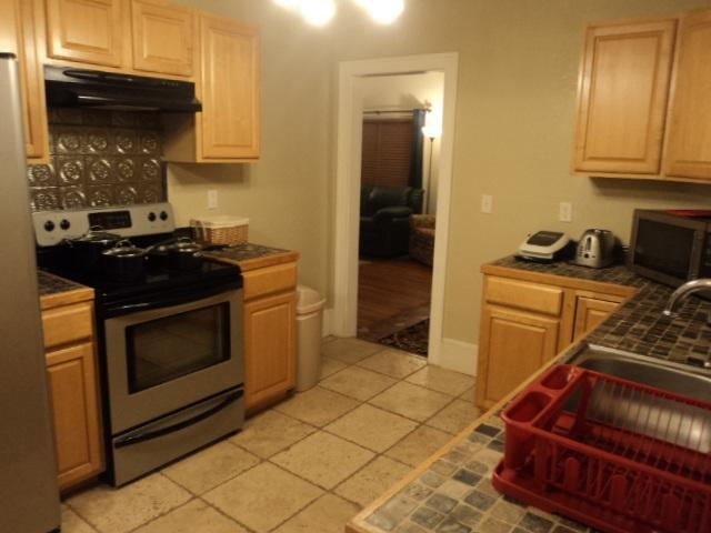 Kitchen on 1st floor with view to Dining Room & Living Room - Spanish Charmer By Beach & Entertainment District! - Daytona Beach - rentals