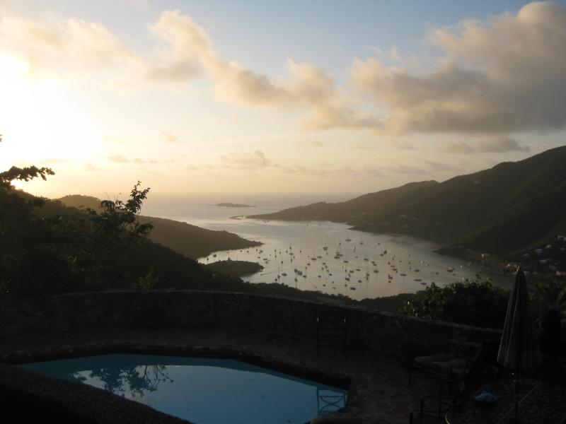 Sun setting over the harbor - Stonehouse with Pool and Amazing Coral Bay Views - Coral Bay - rentals