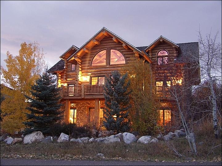 Exterior of this 3-Level, Custom Log Home with wraparound deck and patio. - Private Shuttle Service or Discounts Available for Ski Season Guests - Large, Luxurious Home - Custom Architecture, Upscale Amenities (2235) - Steamboat Springs - rentals