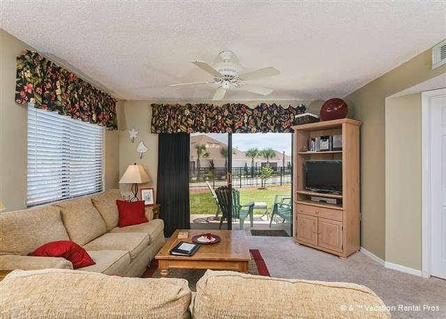 A view of our beautifully furnished living room with a new HDTV - Ocean Village E12, Ground Floor Unit, HDTV, 2 pools, tennis - Saint Augustine - rentals