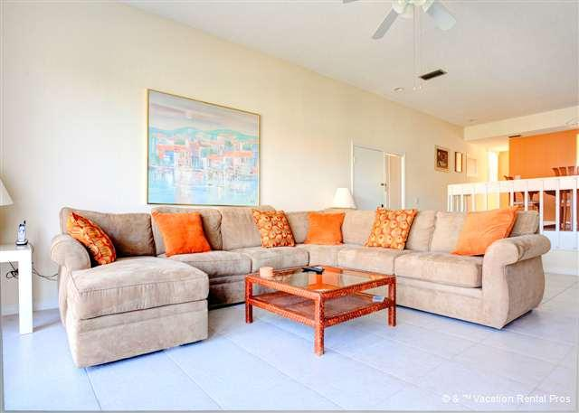 Sink into our comfy sectional for a cozy night at home - Our House at the Beach 222, with Heated Pool, Tennis - Siesta Key - rentals