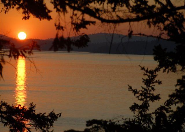The great room and deck are illuminated by magnificent sunsets. - Aria da Capo on Lopez Island - Lopez Island - rentals