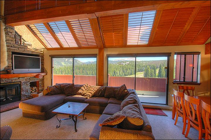 The Living Area Featuring a Large Stone Fireplace and Comfortable Furnishings - Penthouse Suite - Beautiful Resort Views (13256) - Breckenridge - rentals