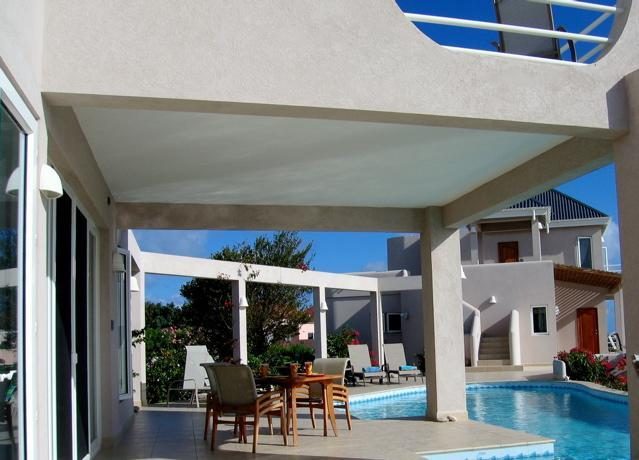 Patio space shaded by balcony of Master Villa, and view of Guest Villa. - BestValueRent 900/5bd/night LUXURY/POOL Rent 1or 5 - Long Bay Village - rentals