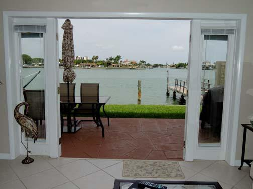 Your own private patio with water just outside the french doors. - Stunning condo w/ Private Patio 10 ft. from water! - Treasure Island - rentals