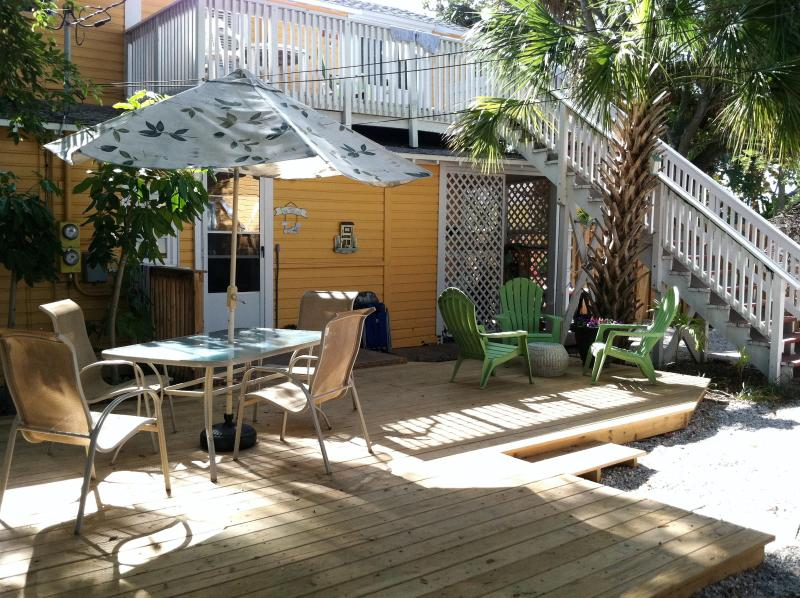 Outdoor courtyard with deck, grill, table, and outdoor shower (under stairs) - Cottage by the Beach - 3 renting Options! - Indian Rocks Beach - rentals