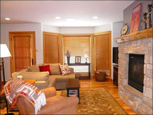 Spacious Living Area with a Gas Fireplace and Flat Screen TV - Beautiful Views of Trail Creek and Mt. Baldy - Cozy Two-Story Condominium (1159) - Ketchum - rentals