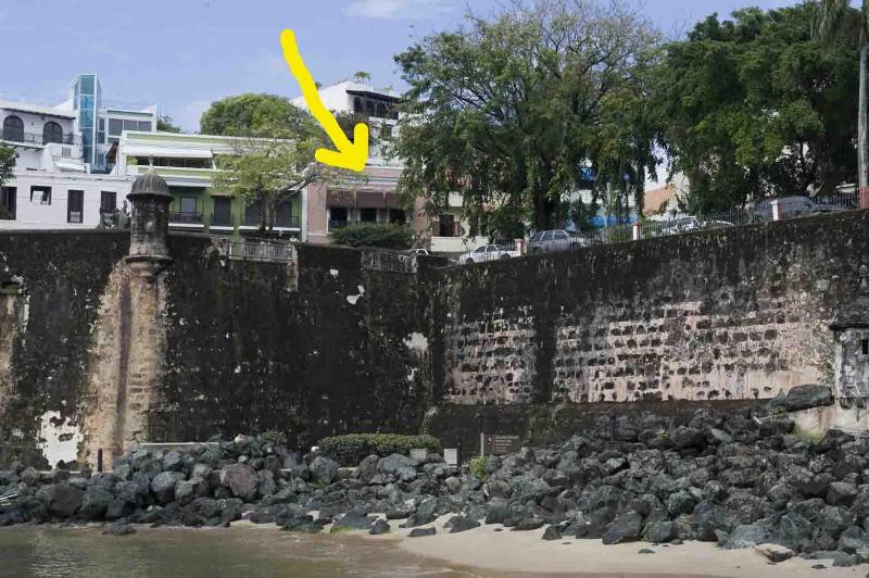 Arrow shows house . Photo taken from pier below.  Bayside walkways can be seen. - 2ND FL APT W GREAT BAYVIEW ON  EXCLUSIVE  OSJ ST - San Juan - rentals