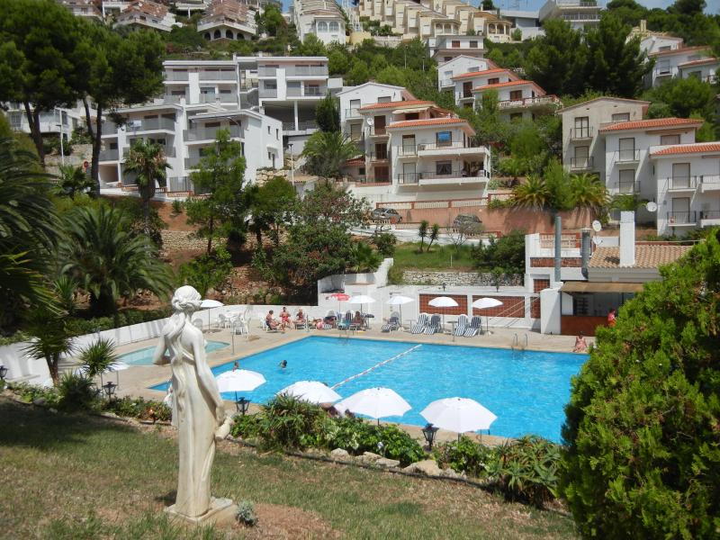 Public pool; apartment in background just to the upper left from the pool - Mountainside View of Mediterranean Coast - Peniscola - rentals