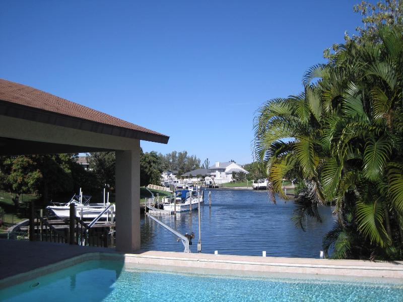 View of pool - rear deck - overlooking the Water - Waterfront Dream- 4 bedroom, epic pool and views - Bradenton - rentals