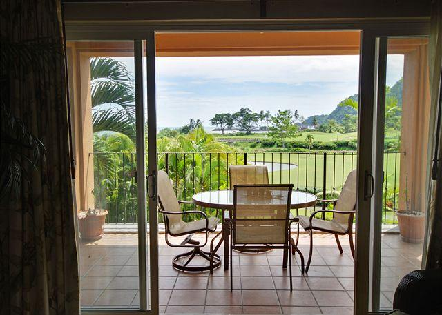 The balcony with ocean and golf course view. - Your Dream Vacation Condo w/OceanView, Pay 3 nights and Stay 4! - Herradura - rentals