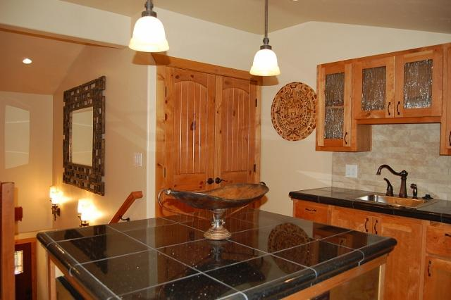 Kitchen with Knotty Cherry Cabinets and Granite countertops - Moab Top Vacation Rental - Moab Condo - Moab B&B - Moab - rentals