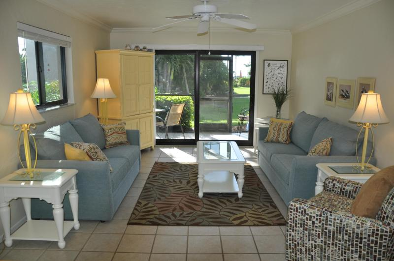 Living Room-Looking Towards Lanai-3D1 - SANDALFOOT 3D1--2 BR MAGICAL RETREAT (1st floor) - Sanibel Island - rentals