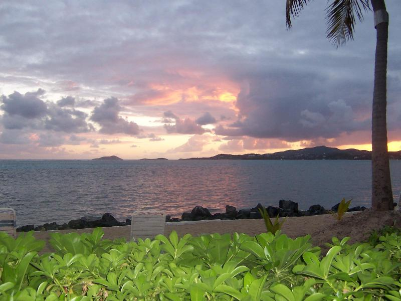 The view from the lanai - Walk out to sand & sea from our renovated condo - Christiansted - rentals