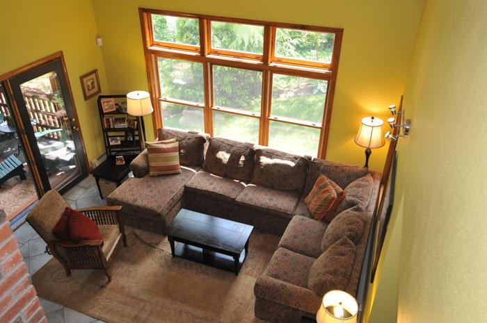 Living Room with cathedral ceiling, 2 story fireplace , SAT TV and attached to screened porch overlooking waterfront - SALE - Sunday River Ski House - $500 OFF + 2 NIGHTS FREE  FOR XMAS WEEKEND! - Bethel - rentals