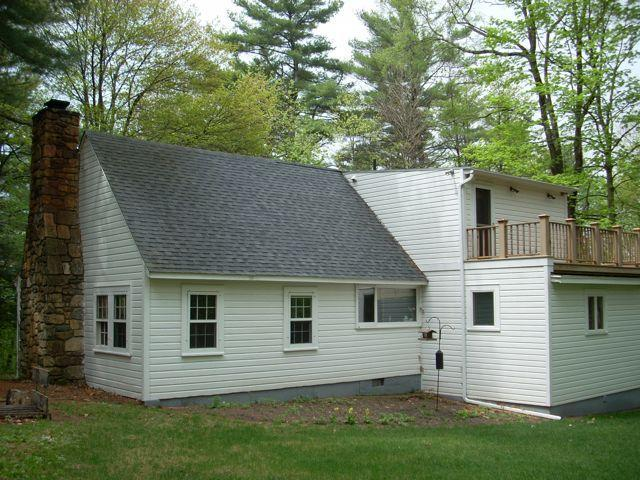 Back view showing 2nd story deck off the master bedroom - Berkshires House, 40 wooded acres, Lake Frontage - Monterey - rentals