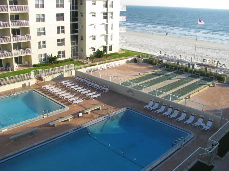 View from our balcony - Sea Coast Gardens Condo with view of Atlantic Ocean - Access to Olympic Size Pools and 4 Lighted Shuffleboard Courts - 2BR/2BA CONDO;GREAT VIEW & RATES BOOK FOR SUMMER! - New Smyrna Beach - rentals