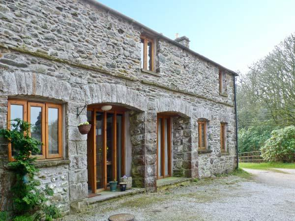 MORESDALE BANK COTTAGE, stone built cottage, with three bedrooms, woodburning stove, and garden, in Greyrigg, Ref 14694 - Image 1 - Kendal - rentals