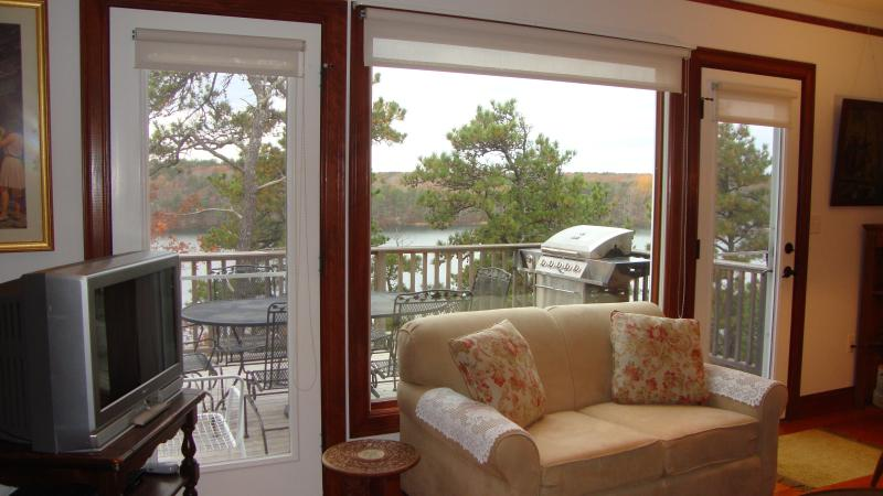 Patio view from the living room - Perfect Vacation  Home - Sheep Pond  Brewster - Brewster - rentals