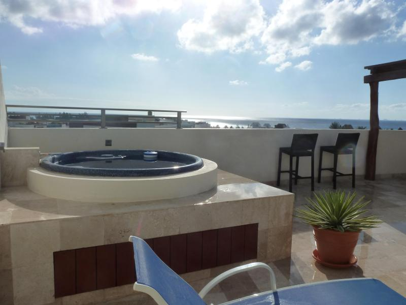 Relax in the jacuzzi and enjoy the ocean view. - 2 Bdrm Luxury Penthouse-Ocean View-Great Price - Playa del Carmen - rentals