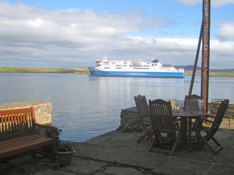 Private pier at 40 Alfred Street Cottage with a view of the passing ferries - 2 bedroom Cottage - 1800's luxury waterfront Anderson Harbour Cottages - Stromness - rentals