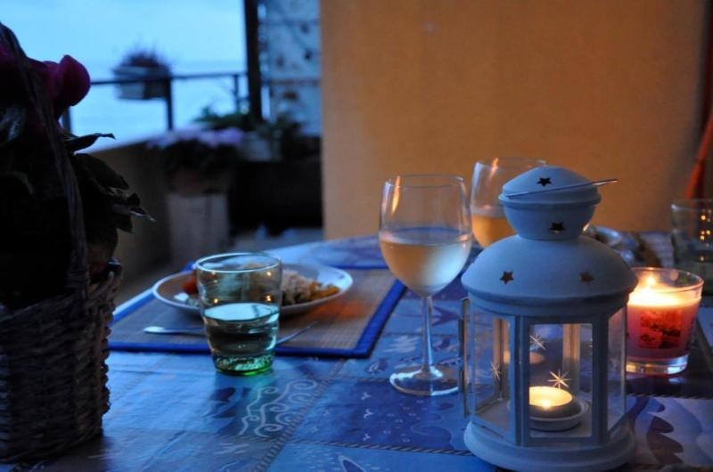 Dinner time in the veranda - RICCIO DI MARE bright flat on the sea of Syracuse - Fiumefreddo di Sicilia - rentals