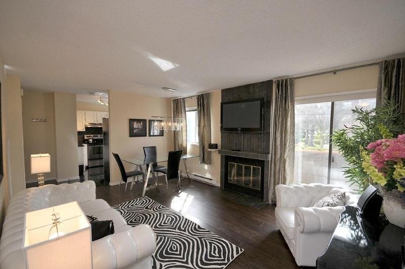 "Living Room with 46"" LCD Smart TV above Fireplace - Renovated Townhouse Near Downtown - Victoria - rentals"