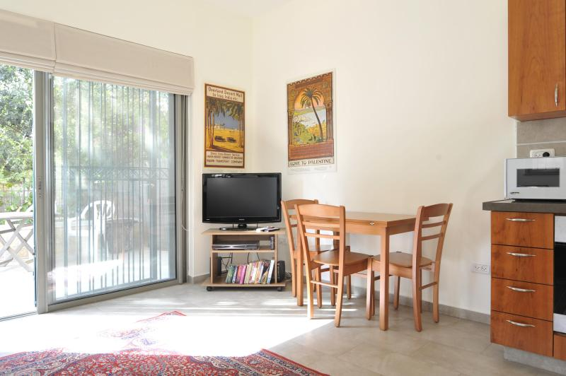 Living Room opens up to private patio - BEAUTIFUL 1 BR IN HEART OF J'LEM'S CULTURAL MILE - Jerusalem - rentals