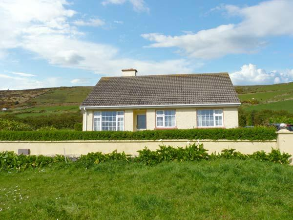 ST FINIANS BAY COTTAGE, a single storey, detached cottage, with open fire, and lawned gardens, in Ballinskelligs, Ref 15299 - Image 1 - Ballinskelligs - rentals