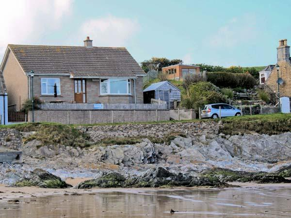 BEACH COTTAGE, detached cottage, with sea views, open fire, walking distance to beach, in Sandend, Ref 12172 - Image 1 - Cullen - rentals