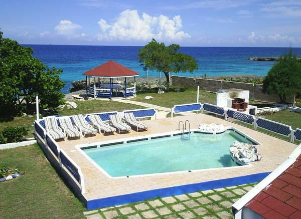 PARADISE PMO - 43534 - GREAT VALUE | 6 BED OCEANFRONT VILLA WITH POOL - DISCOVERY BAY - Image 1 - Discovery Bay - rentals