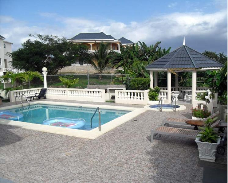 PARADISE PWH - 43703 - SERENE SANCTUARY - 5 BED VILLA | POOL | GREAT SEAVIEWS - OCHO RIOS - Image 1 - Ocho Rios - rentals