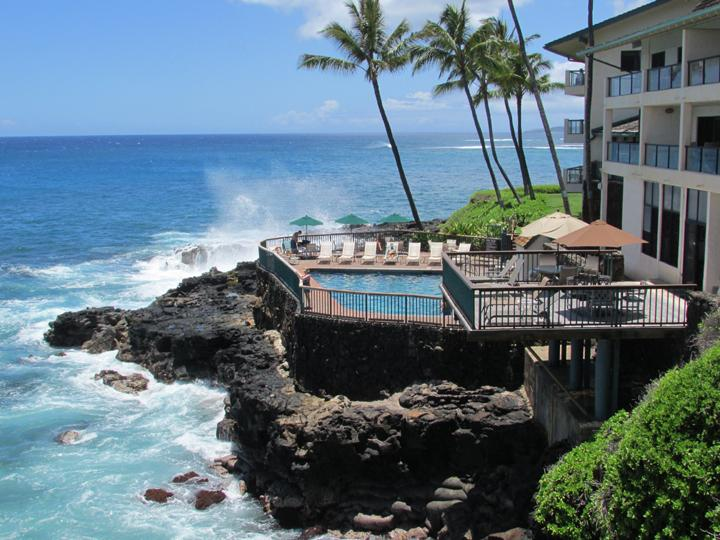 Yes, the lanai does actually sit over the ocean, turtles in the water below, surfing the waves. - Poipu Shores #102B New Remodel One BR Oceanfront! - Poipu - rentals