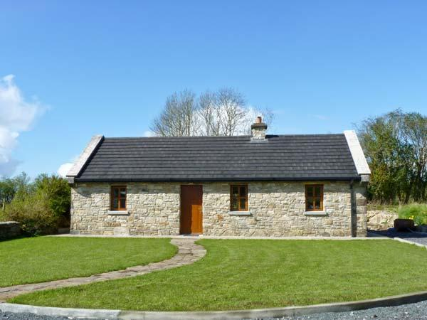 CREGAN COTTAGE, character, single storey cottage with solid-fuel stove and attractive gardens, in Drumagh, Ref 15209 - Image 1 - Swinford - rentals