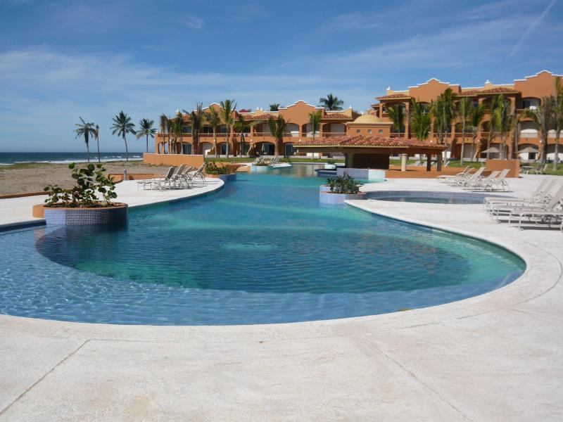 Pool on the Ocean with Condo to the right of the Pool - 2 Bedroom Ocean Front Condo on Beach with Golf - Mazatlan - rentals