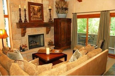 Living area with gas fireplace, flat screen TV, vaulted ceilings, balcony - Located one block from the center of Vail Village with nearby Gold Peak and Gondola 1. - Vail - rentals