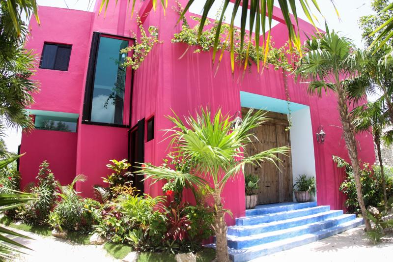 View of the left side of the front of the house. - The Pink House: 3BR Fantasy World on Soliman Bay - Soliman Bay - rentals