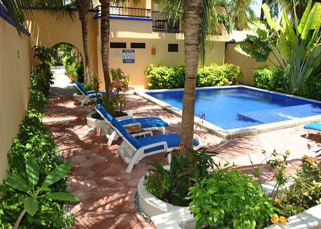 Looking from your patio to the pool - ONE BLOCK TO BEACH, APARTMENT, POOL, BBQ, OFFICE, RELAXING, QUITE, FREE WI FI - Puerto Morelos - rentals