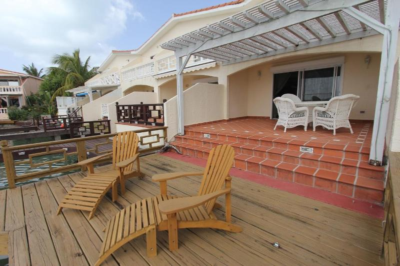 Outside patio and deck - The Pelicans, 404B Waterfront 2 Bedroom Villa - Jolly Harbour - rentals