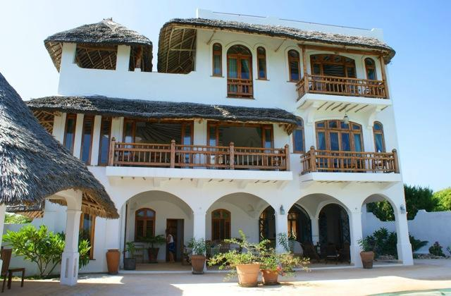 The house is set over three floors with a double height ceiling on the ground floor. - Kusini - Stunning Beach Front House - Watamu - rentals