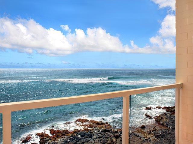 4th (top) Floor Lanai - watch whales (in season) and sea turtles! - Kuhio Shores 412 Oceanfront Condo, Poipu, Kauai - Poipu - rentals