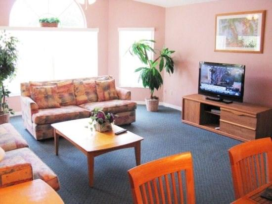 Living room with Flat screen Tv and free WiFi - Beautiful Upper Floor 3 Bedroom Villa, close to Disney - Kissimmee - rentals