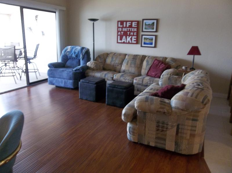 Living room area with sleeper sofa, love seat, recliner, wood floors - Beautiful Newly Remodeled Condo!! WIFI, Gas Grill - Lake Ozark - rentals